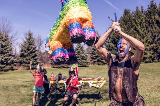 A person hitting a pinata with determination and force